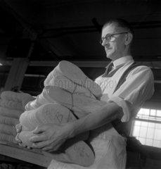 Man carrying soles  shoe factory  1948