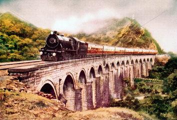Steam locomotive crossing a viaduct  India  c 1930s.