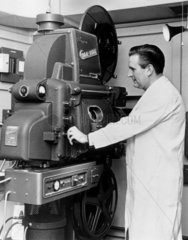 House engineer with Cinemeccanica projector  Odeon Cinema  c 1950s.