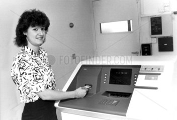 Withdrawing money from a cash machine  19 August 1986.