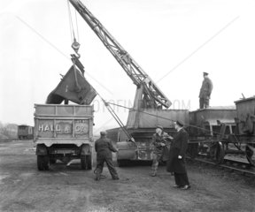 Workers unloading stone  Stansted goods yard  Essex  January 1954.