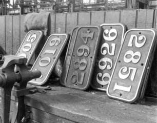 A collection of brass number plates at Swin