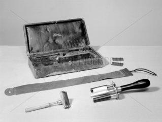 Cased safety razor set with stropping machine  c 1900.