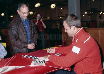Rubens Barrichello  Brazilian racing driver  signing autographs  2002.