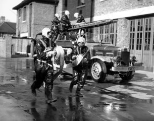Running out the water hoses  27 January 193