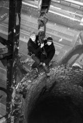 Steeplejacks on top of a chimney  March 1973.