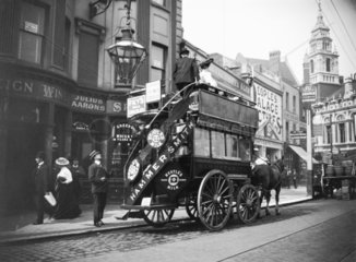 Horse-drawn open-topped bus in Hammersmith  West London  c 1910s.