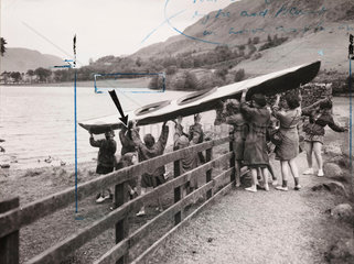 Lauching a canoe on Buttemere on a girls' Outward Bound Course  1954