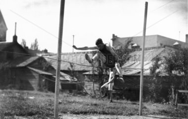 High jumper in action  c 1920s.