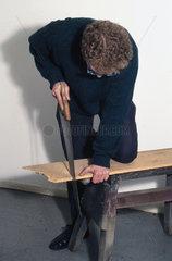 Man sawing wood  1997.