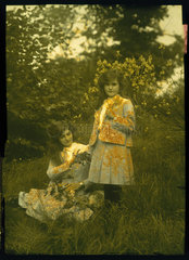 Autochrome of two young ladies with matching hair and outfits  c 1910.
