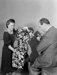 Woman showing a man a dress  1948.