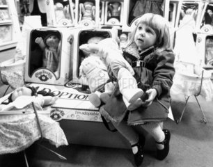 Little girl with a Cabbage Patch Kid  December 1983.