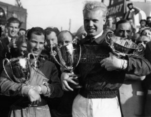 Mike Hawthorn and Stirling Moss with trophies  Silverstone  11 May 1953.