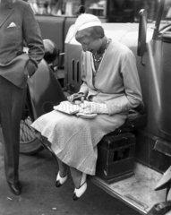 Frau Charly Caracciola timing a race  Berlin  1932.