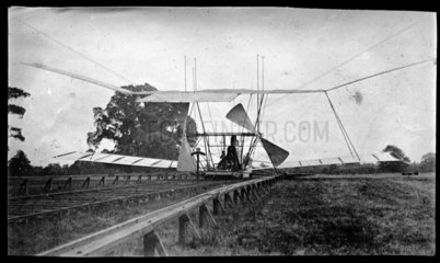 Maxim's flying machine on its launch track  seen from behind  1894.