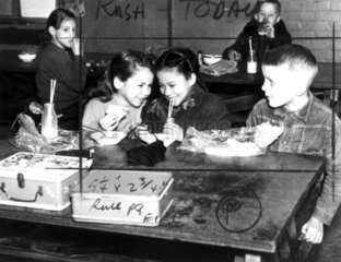 Primary school children eating lunch  2 September 1957.