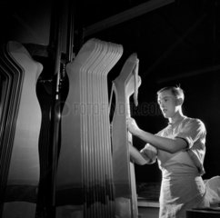 An Aristoc worker forming tights on card templates  1954.