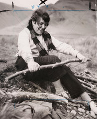 Breaking up firewood on a girls' Outward Bound Course  1954