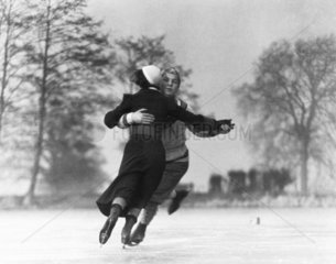 Couple skating on an ice rink  c 1930s.