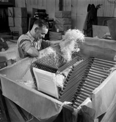 Packing PEL steel and canvas chairs  1948.