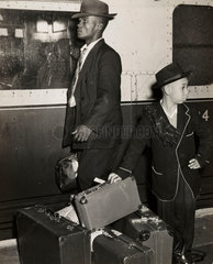 Young Jamaican boy looks after his family's luggage  September 1954 .
