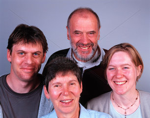 Two brown-eyed parents with their two blue-eyed children.