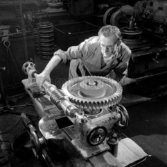 An engineer tests a large gear wheel at David Brown Limited  Huddersfield.