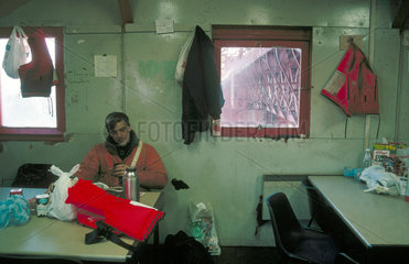 Tea break in 'the bothy' for worker on the Forth Bridge  Scotland  January 1997.