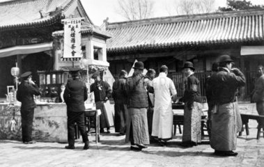 Drinking tea in the street  China  c 1910s.