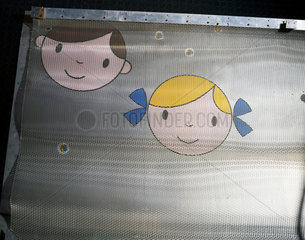 Cartoon faces on the Faraday cage of an MRI scanner  early 1970s.