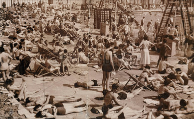 Suntanned - sun seekers at Enfield  6 June 1937.