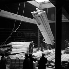 Unloading timber from the hold of the 'Bravo'  Hull docks  1949.