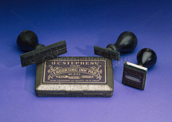 Three rubber stamps and ink pad  early 20th century.
