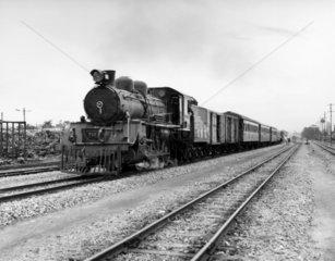 Steam locomotive leaving Thon Buri  Bangkok  Thailand  1970.