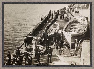 Sailors lined up on deck of battleship  c 1916.