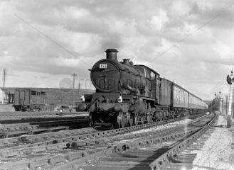 Steam locomotive with carriages  c 1950s.