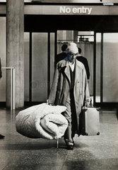 A Kenyan Asian migrant walks through customs at Heathrow  1968.