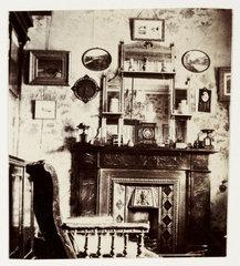 Living room interior  c 1900.