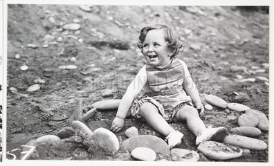 Girl on a beach  c 1930.
