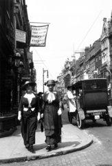 Two women wearing the latest fashions walki