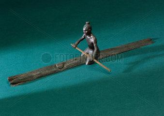 Man paddling a log  1931.