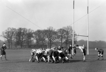 Rugby players engaged in a scrum  c 1930s.