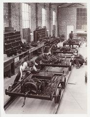 Workers building railway trolleys  c 1930.