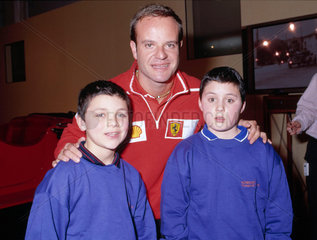 Rubens Barrichello with two boys  Science Museum  London  22 February 2002.