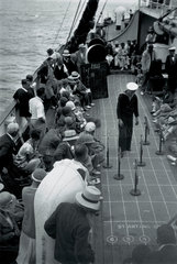 A sailor and passengers on board a liner  c 1930s.