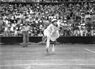 Tennis player Helen Wills Moody in action at Wimbledon  4 July 1935.