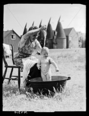 Bathing the baby  15 August 1944.