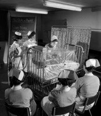 Display of oxygen tents in children's section in nurses training school  1968.