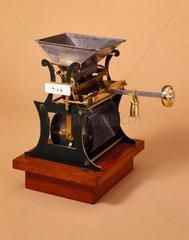 Corn weighing machine  19th century.